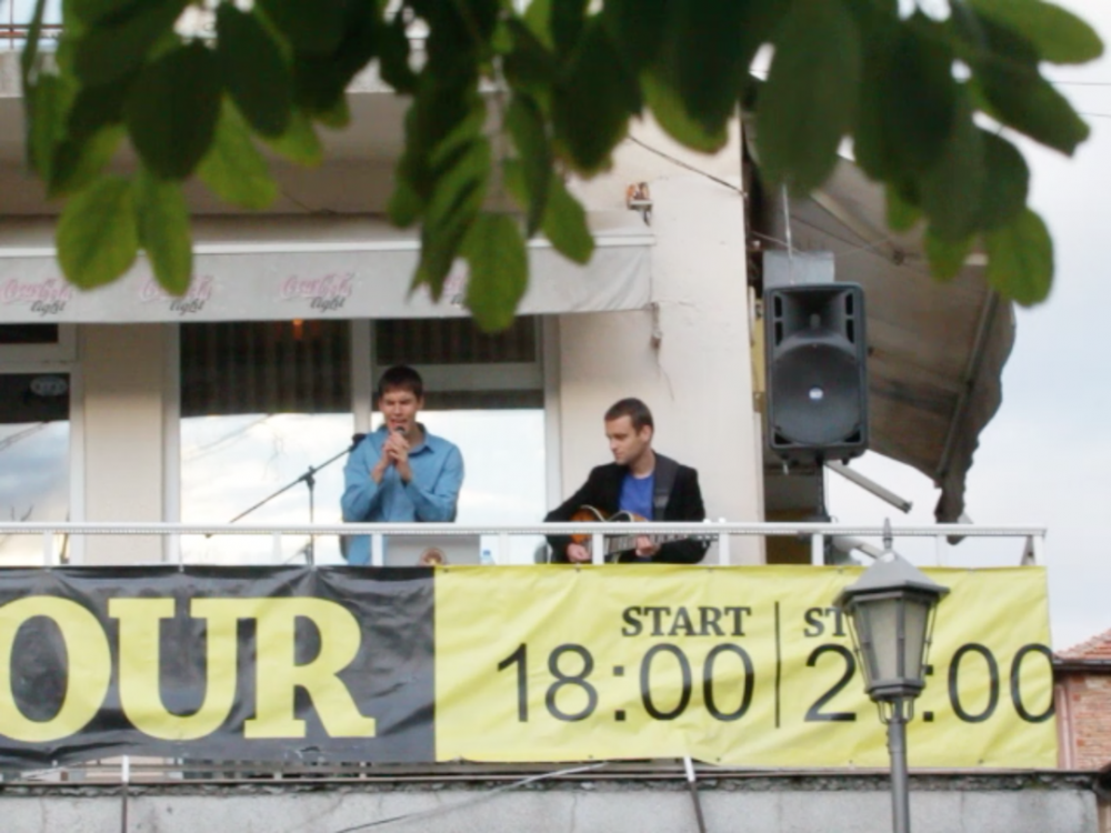 <p>Big Banda performing as a part of the event <em>How to Disable Placemakers</em>. Experience Economies, <em>At Home He's a Tourist</em>, 2014. One Architecture Week, Plovdiv. Photo: Gavin Kroeber.</p>